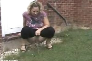 Woman peeing around the house